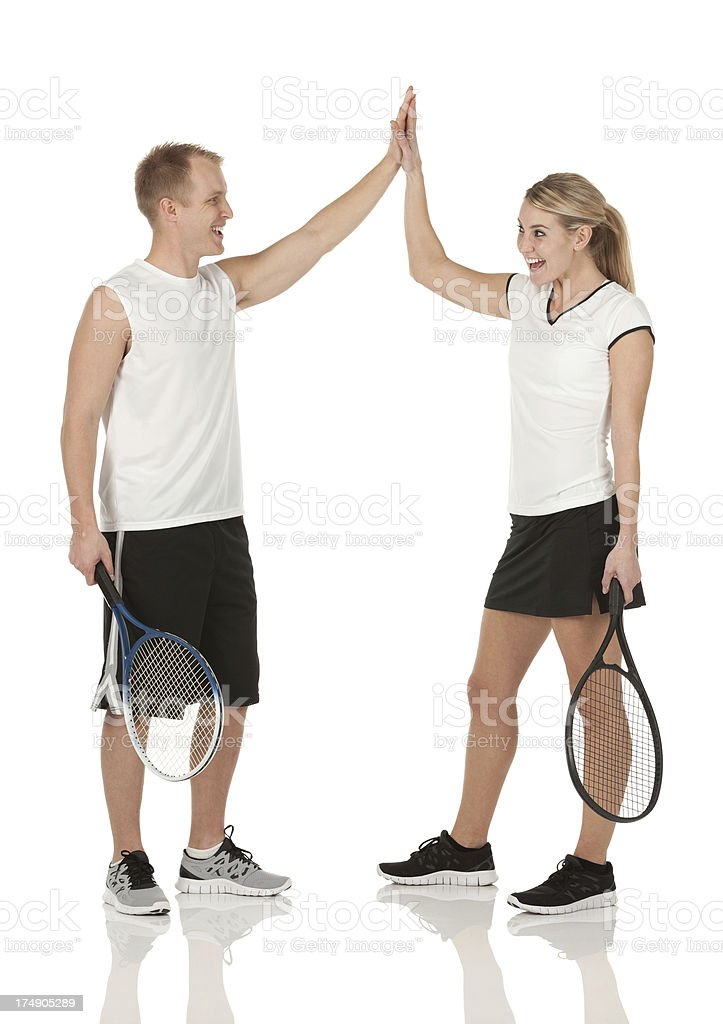 Tennis players giving high-five to each other royalty-free stock photo