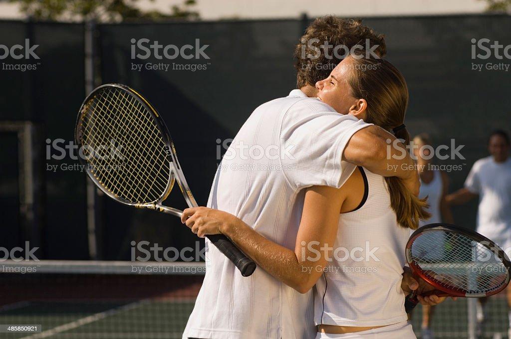 Tennis Players Hugging at Net stock photo