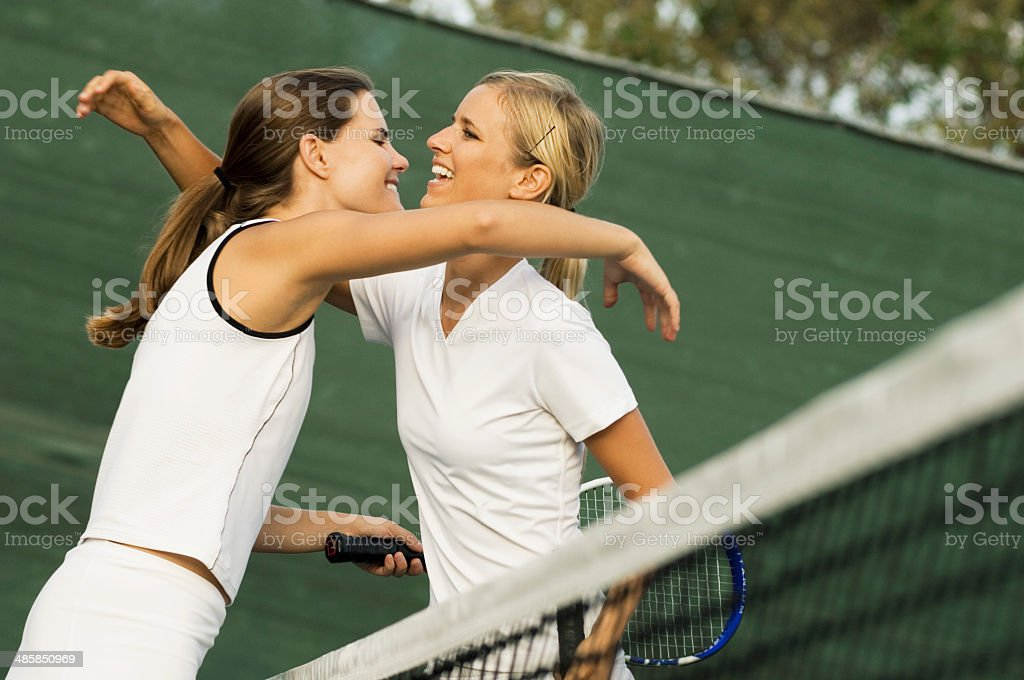 Tennis Players Hugging Each Other After Match stock photo
