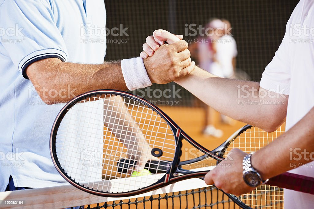 Tennis players shaking hands after match stock photo