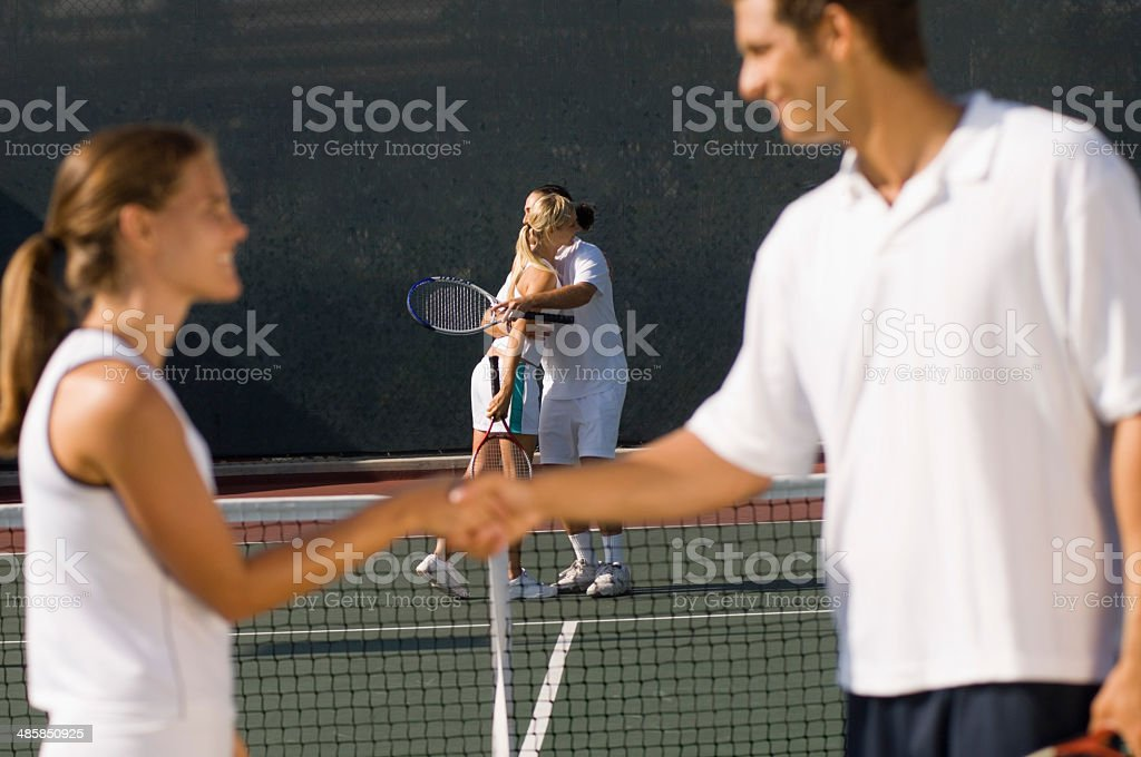 Tennis Players Shaking Hands at Net stock photo