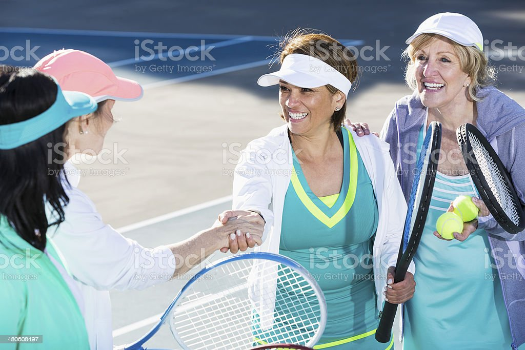 Tennis players shaking hands royalty-free stock photo
