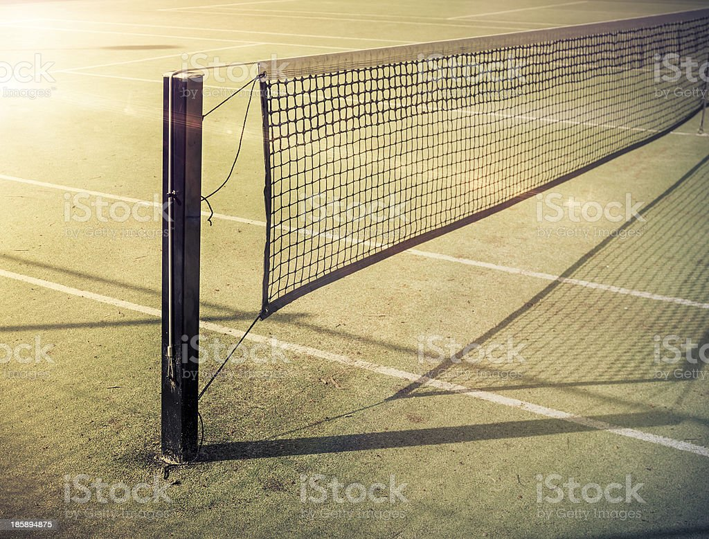 Tennis Post and Net on Grass Court stock photo