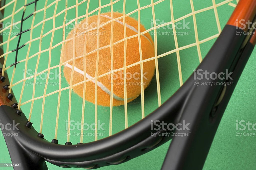 tennis racket and a ball royalty-free stock photo