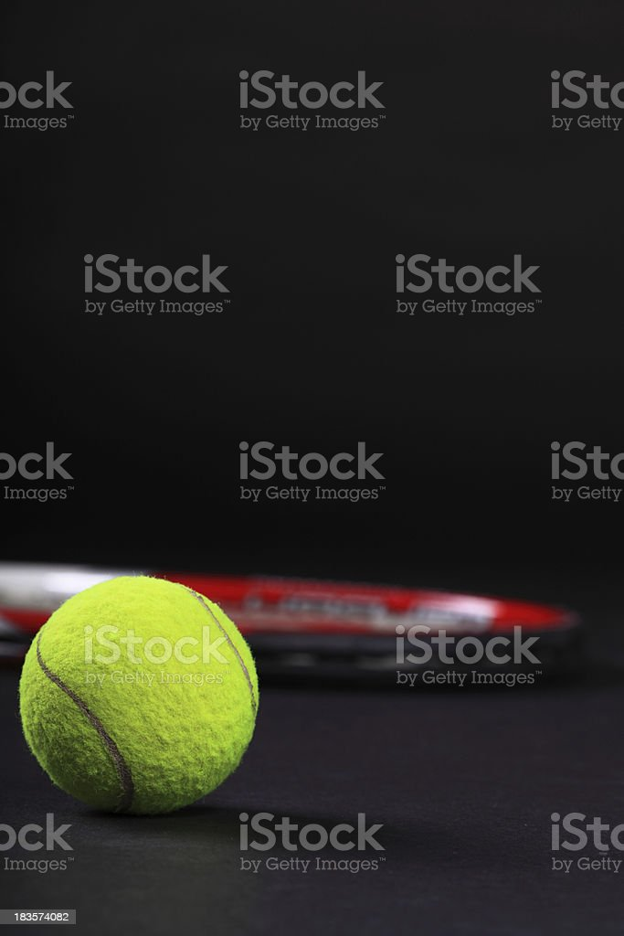 tennis racket and ball on black background royalty-free stock photo