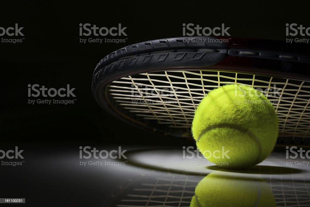 Tennis racket and ball on dark background stock photo