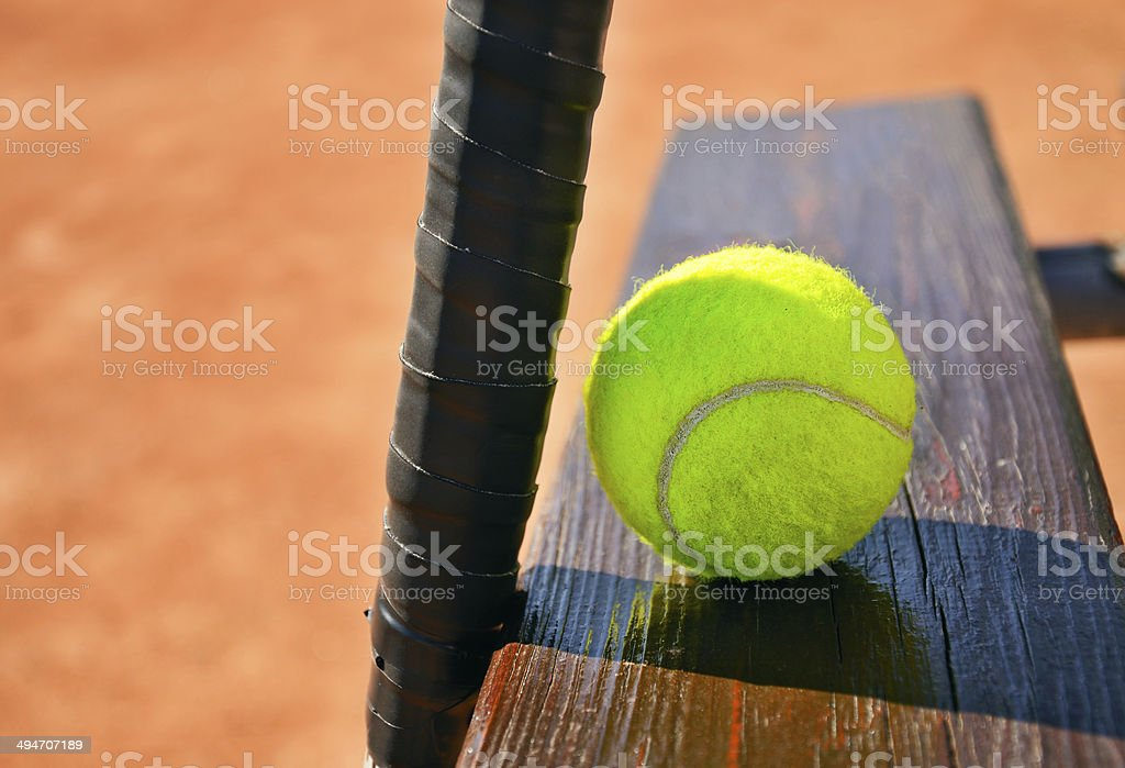 tennis racket and ball on the bench horizontal stock photo