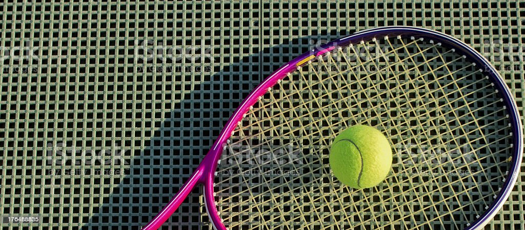 Tennis Racket And Ball On The Squared Ground royalty-free stock photo