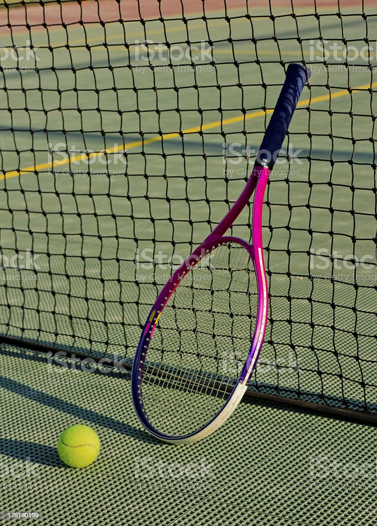 Tennis Racket And Ball Over The Net On Court royalty-free stock photo