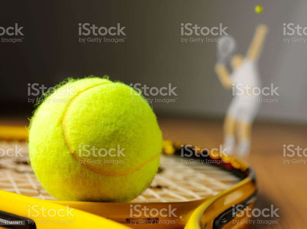 Tennis Racket and Ball with a Player Serving royalty-free stock photo