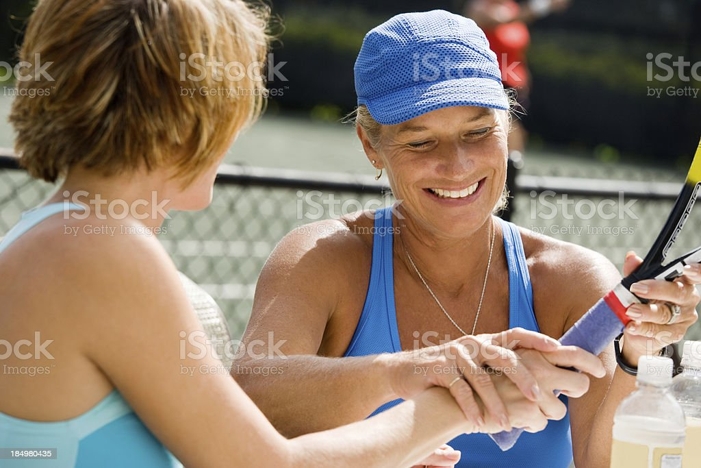 Tennis racket grip demonstration stock photo