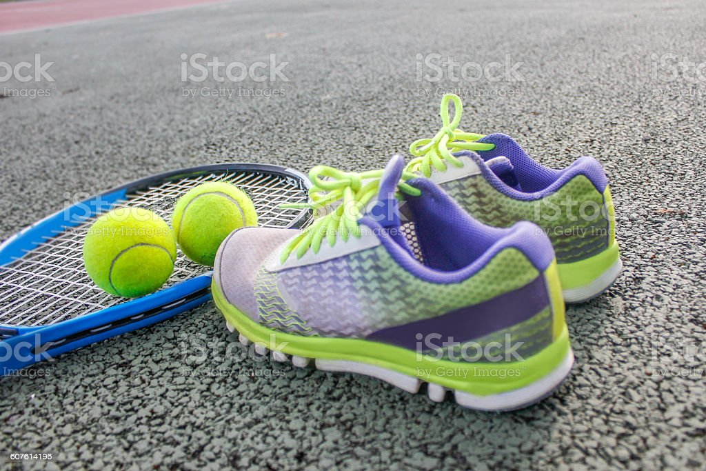 Tennis racket ,tennis ball and sport shoes stock photo