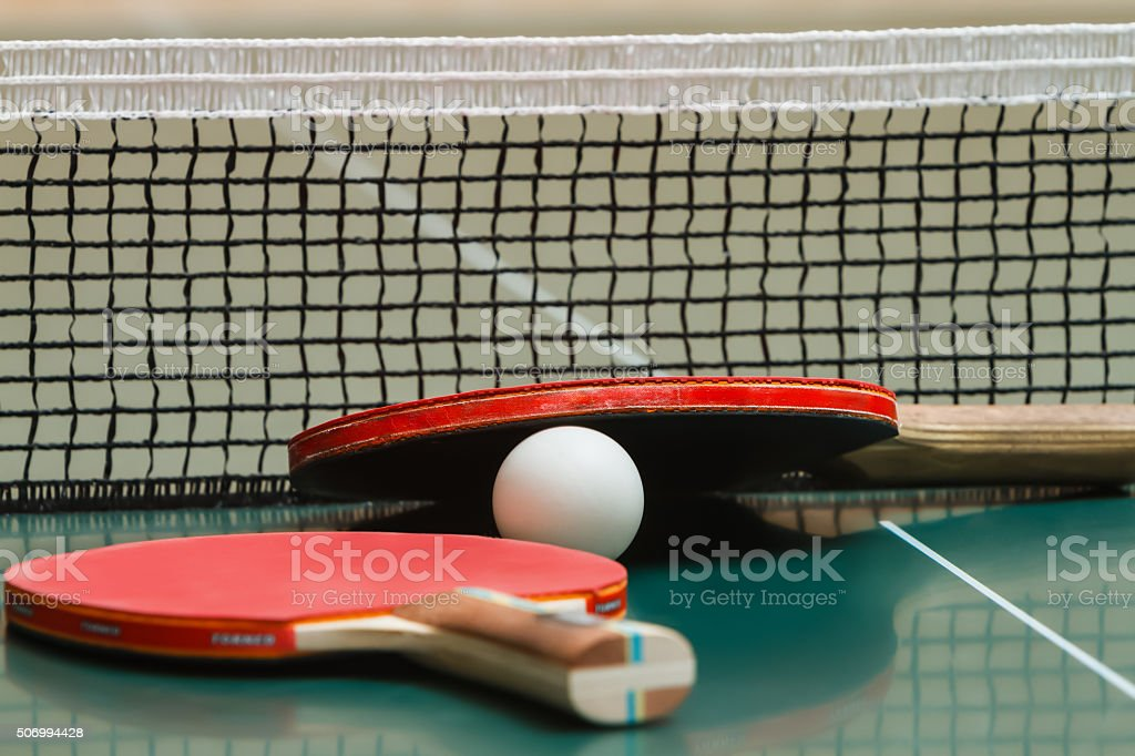 Tennis racket with a ball on the table stock photo
