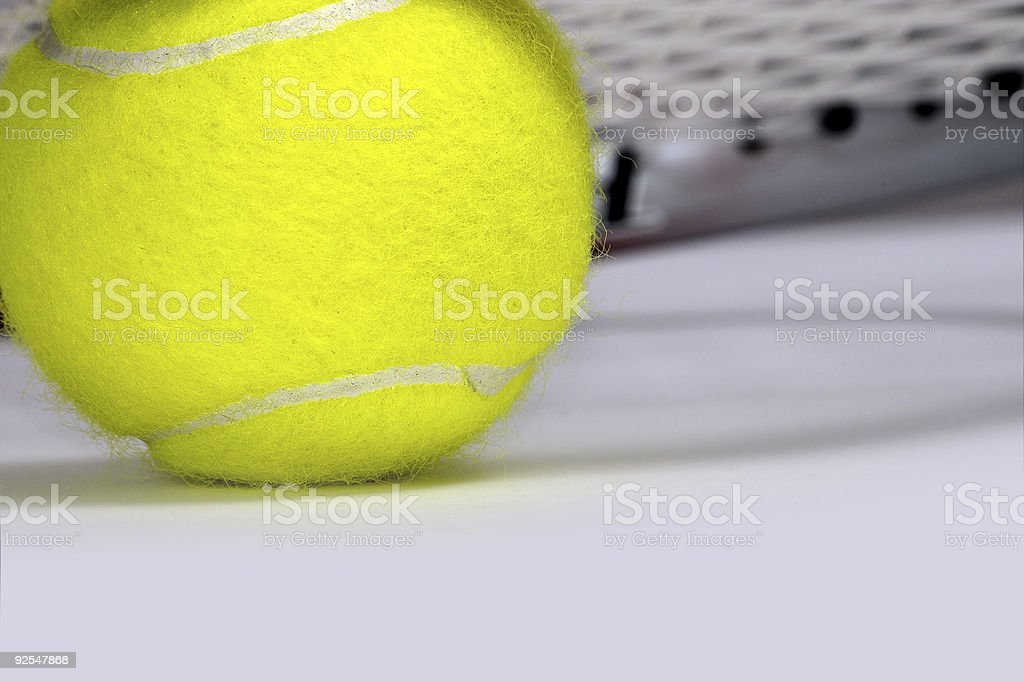 Tennis racket with a ball. royalty-free stock photo