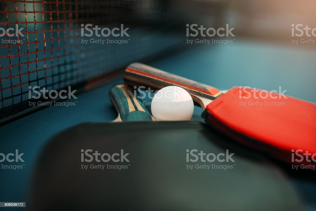 Two tennis rackets and ball on the table closeup, game concept. Ping...