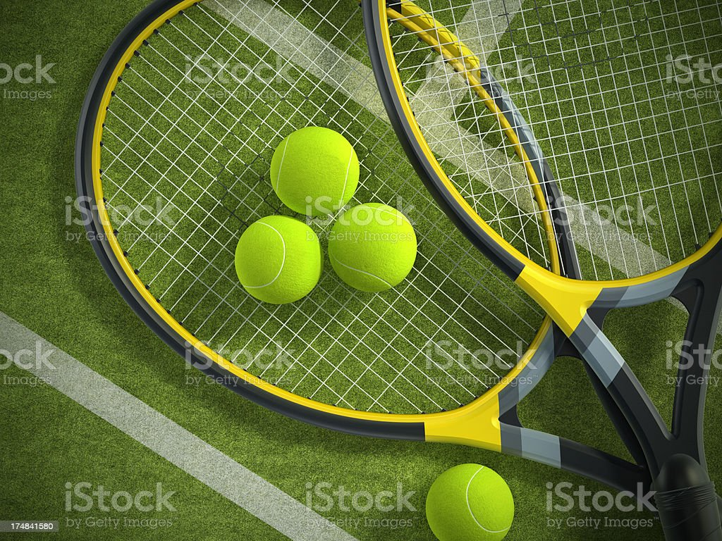 Tennis rackets and balls on court royalty-free stock photo