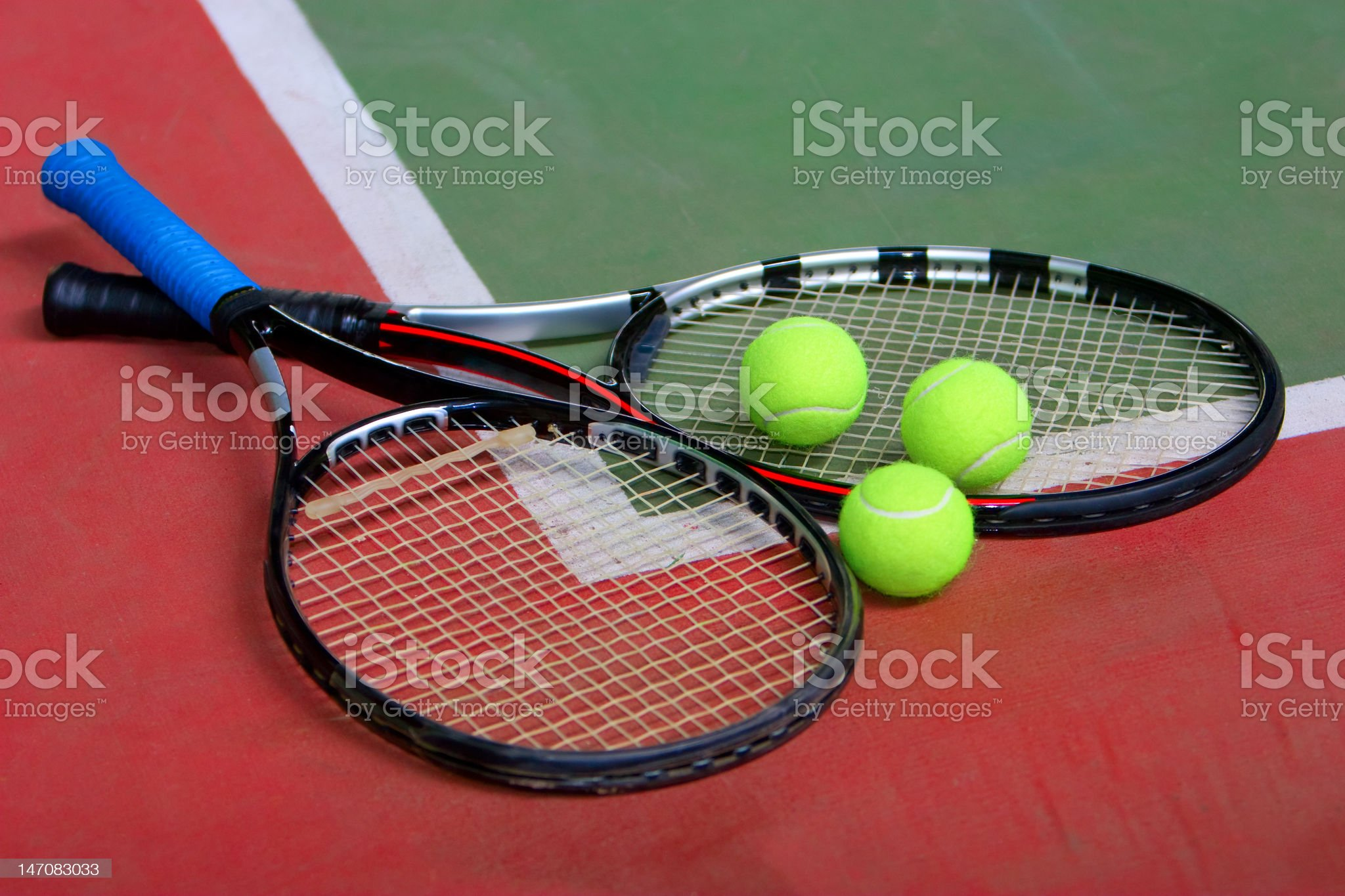 Tennis rackets, balls and court royalty-free stock photo