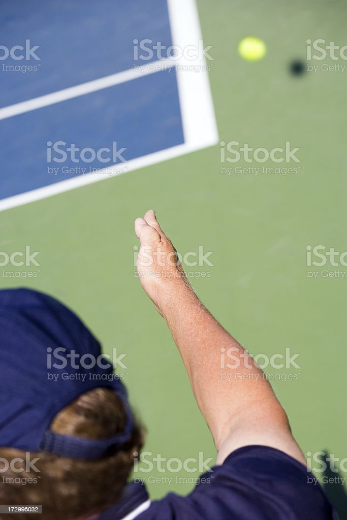 Tennis Referee Signals Ball is Out of Bounds stock photo