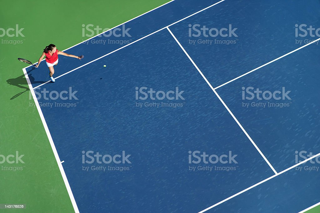 Tennis run around forehand stock photo