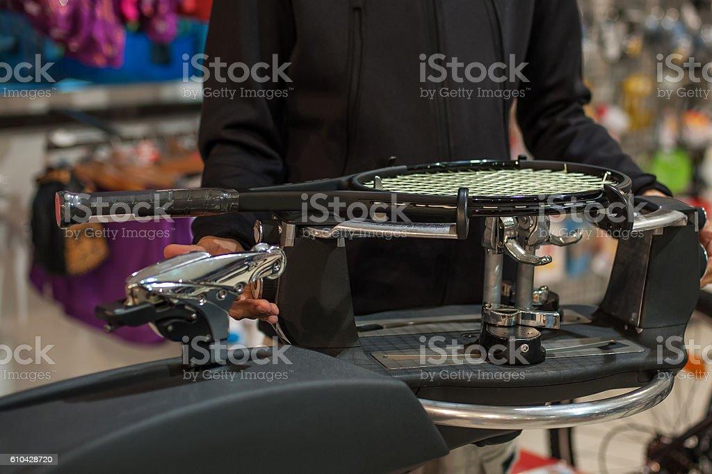Tennis stringer doing racket stringing stock photo