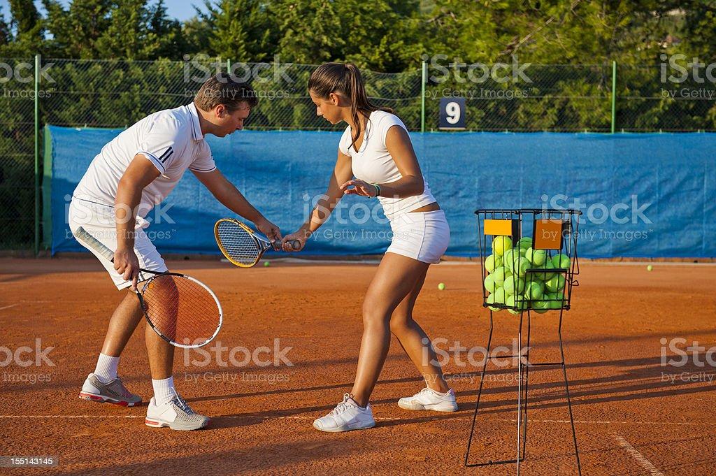Tennis teacher giving lesson royalty-free stock photo