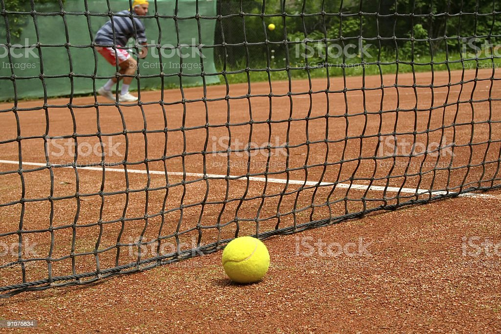 Tennisball on the playing field stock photo