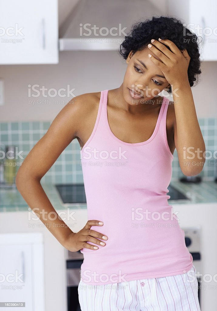 Tense African American lady standing in kitchen royalty-free stock photo