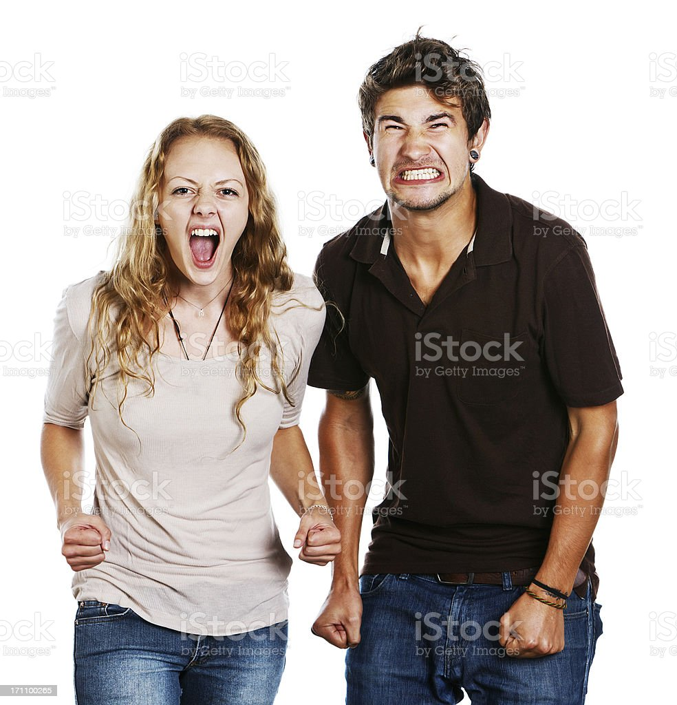 Tense excited young couple grimace and shout stock photo