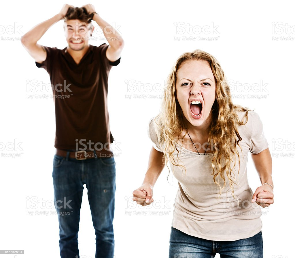 Tense pair grimace and shout in excitement or anger stock photo
