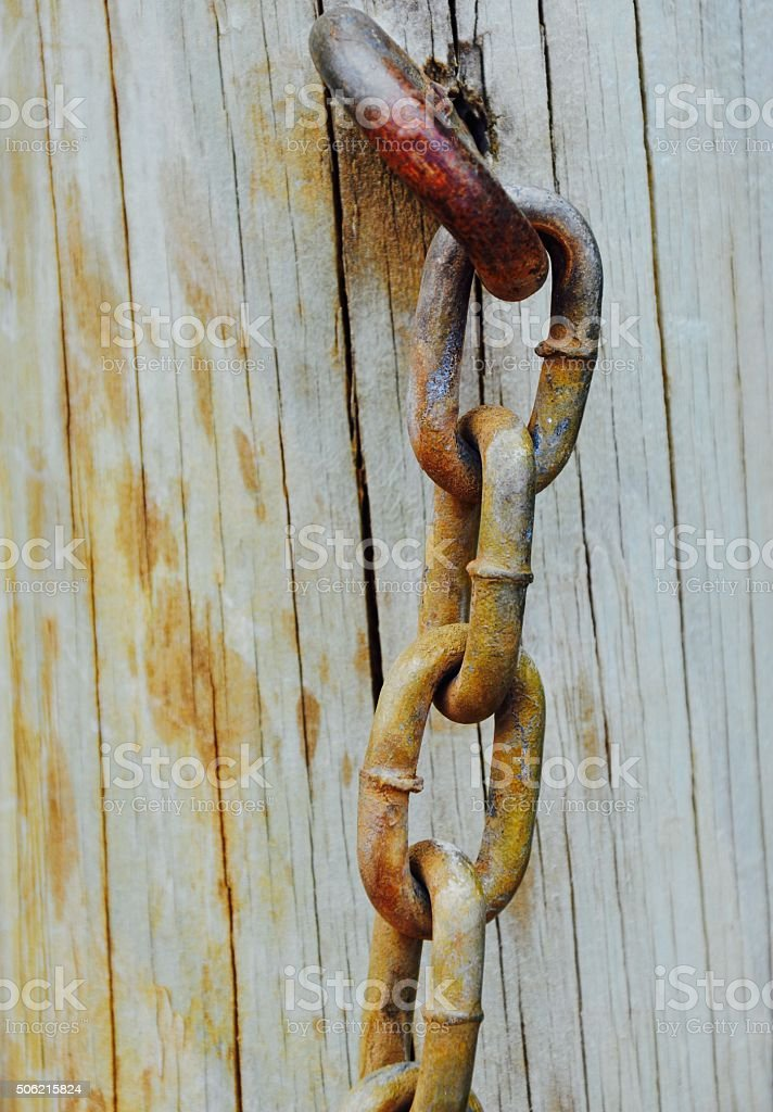 Tense: Rusty Chain stock photo