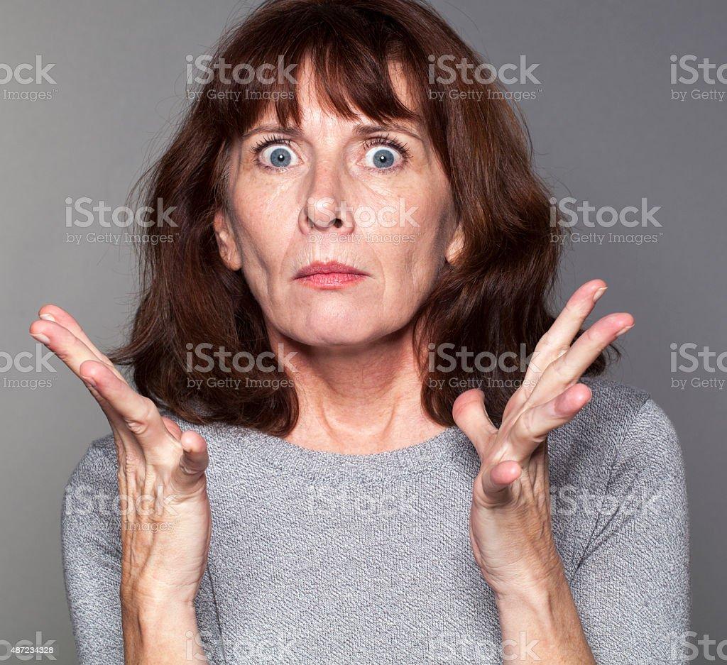 tense senior woman expressing disillusion and exasperation stock photo