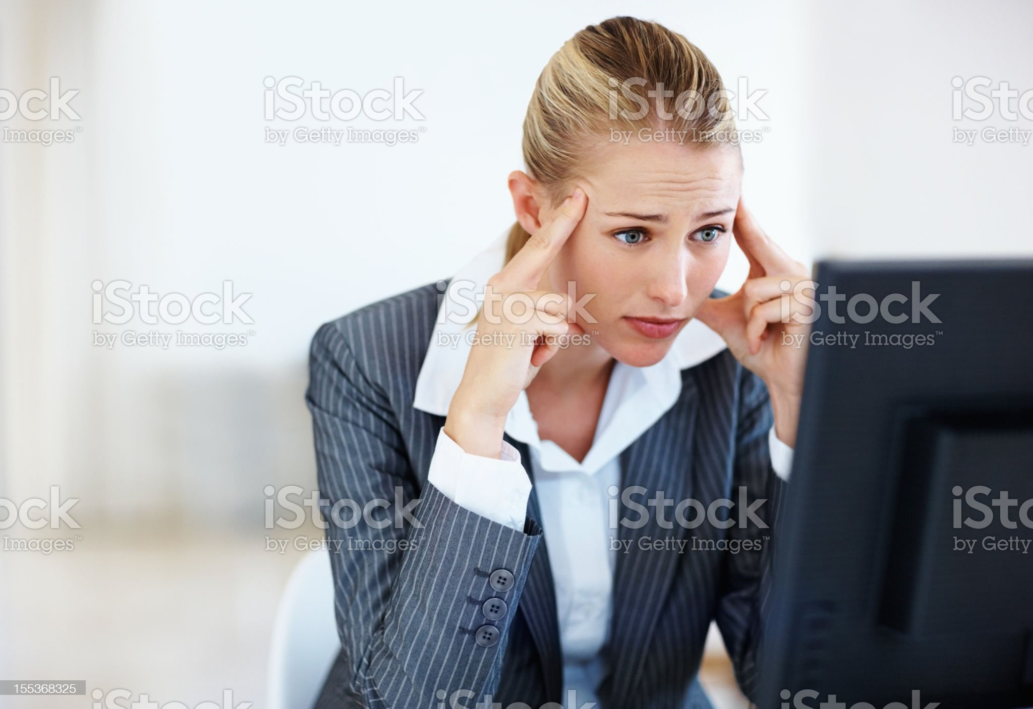 Tensed business woman at work royalty-free stock photo