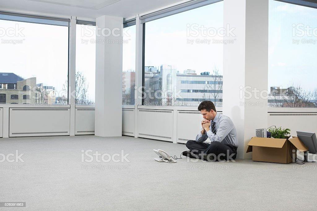 Tensed Businessman In Empty Office Space stock photo