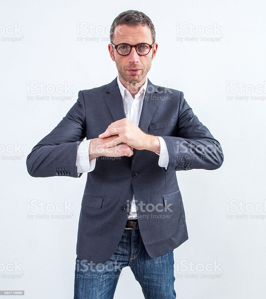 tensed modern businessman waiting with fists together to calm down stock photo