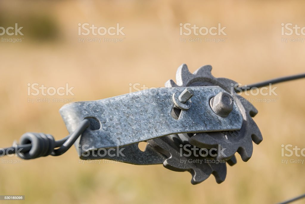 Tensioner for wire fence stock photo