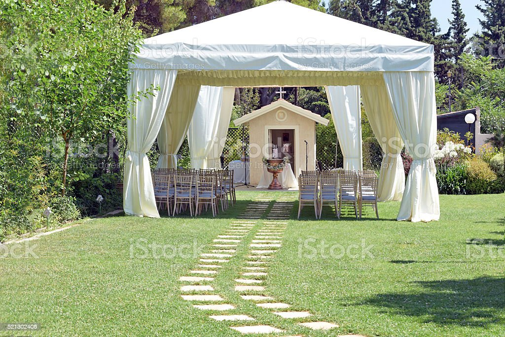 Tent and chairs on grass stock photo