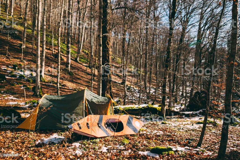 Tent and kayak in the forest. Winter forest in Montenegro, Natio stock photo