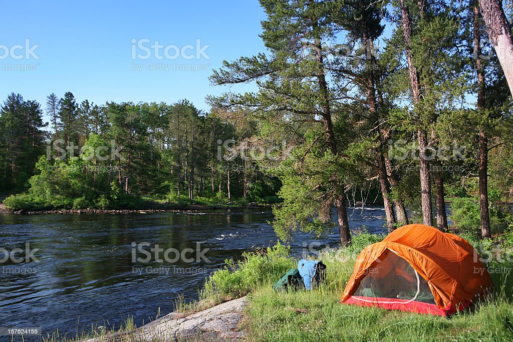 Tent and River stock photo