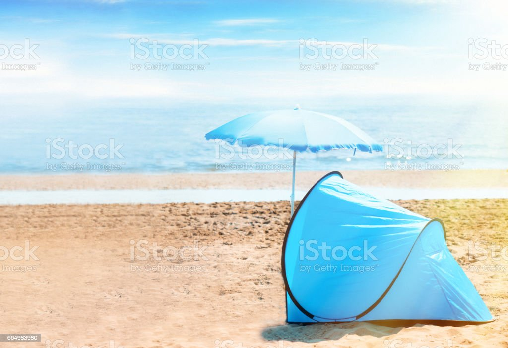 Tent and Umbrella at the Beach stock photo
