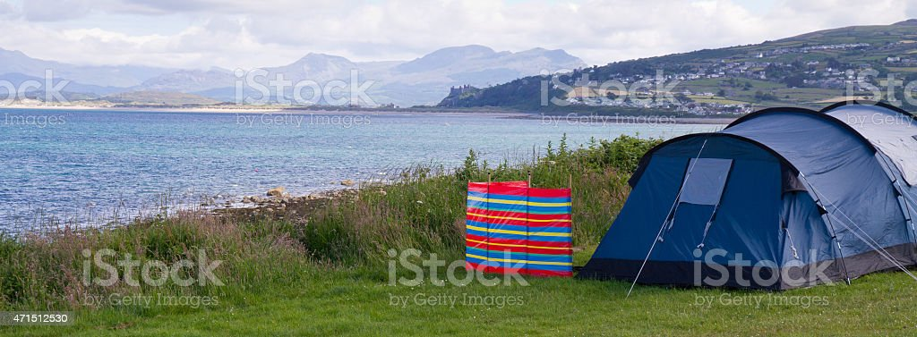 Tent and windbreak by the sea in North Wales, UK. stock photo