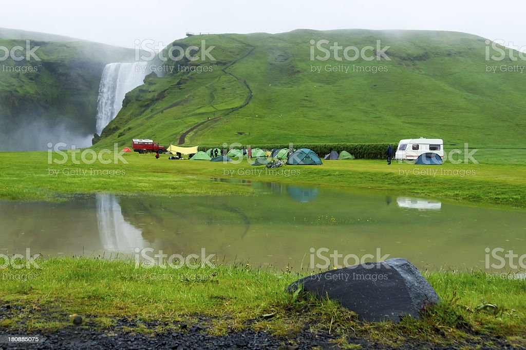 tent camp near Skogarfoss waterfall in Iceland, summer royalty-free stock photo