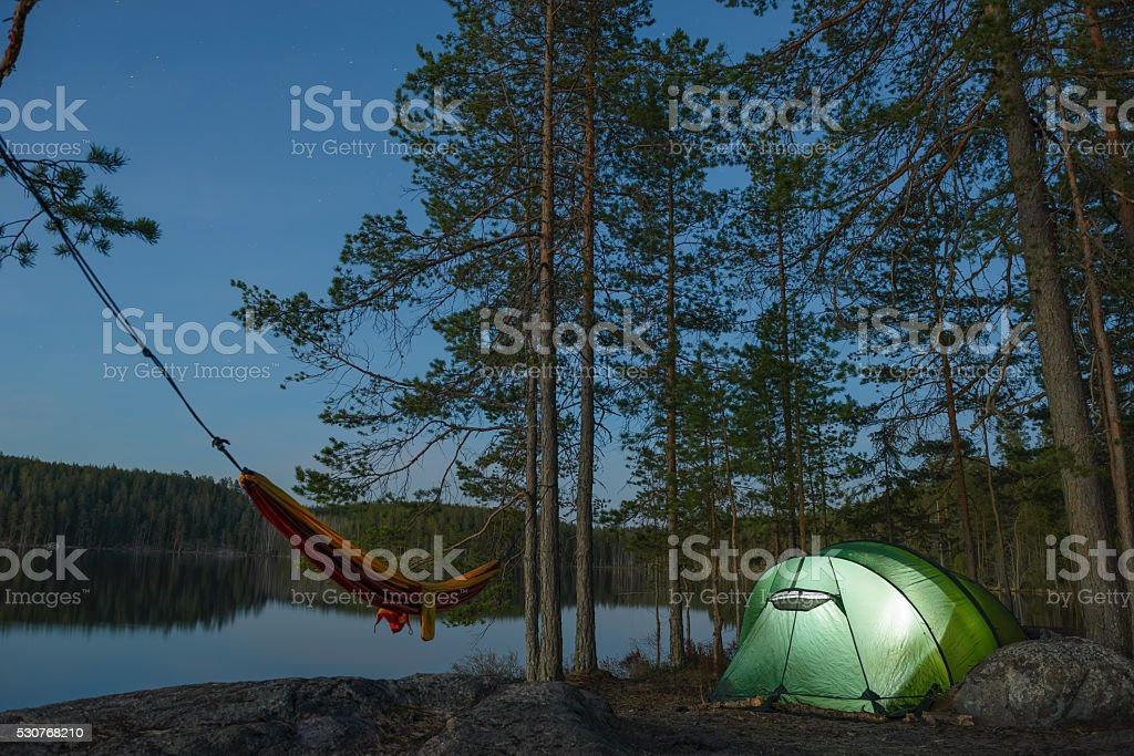 Tent camp standing in forest stock photo