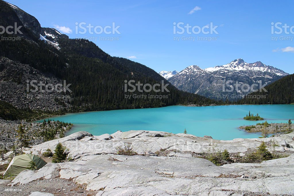 Tent in front of a beautiful glacial lake stock photo