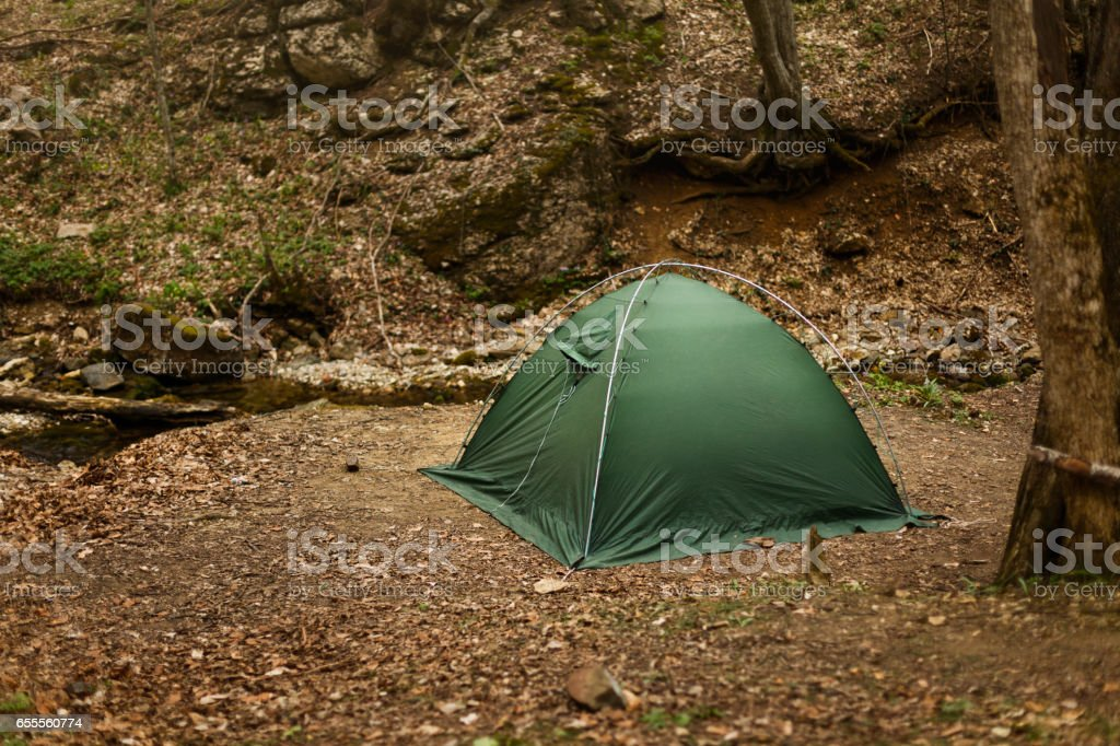 Tent in the middle of a beautiful autumn forest stock photo