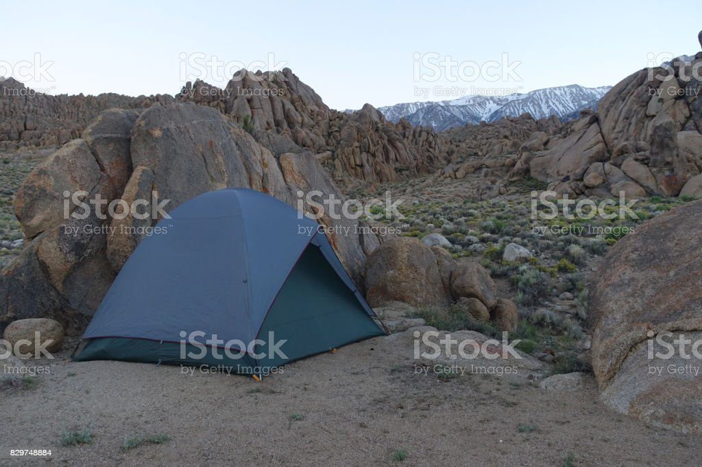 A tent is nestled into the rocks at Alabama Hills, Lone Pine, California stock photo