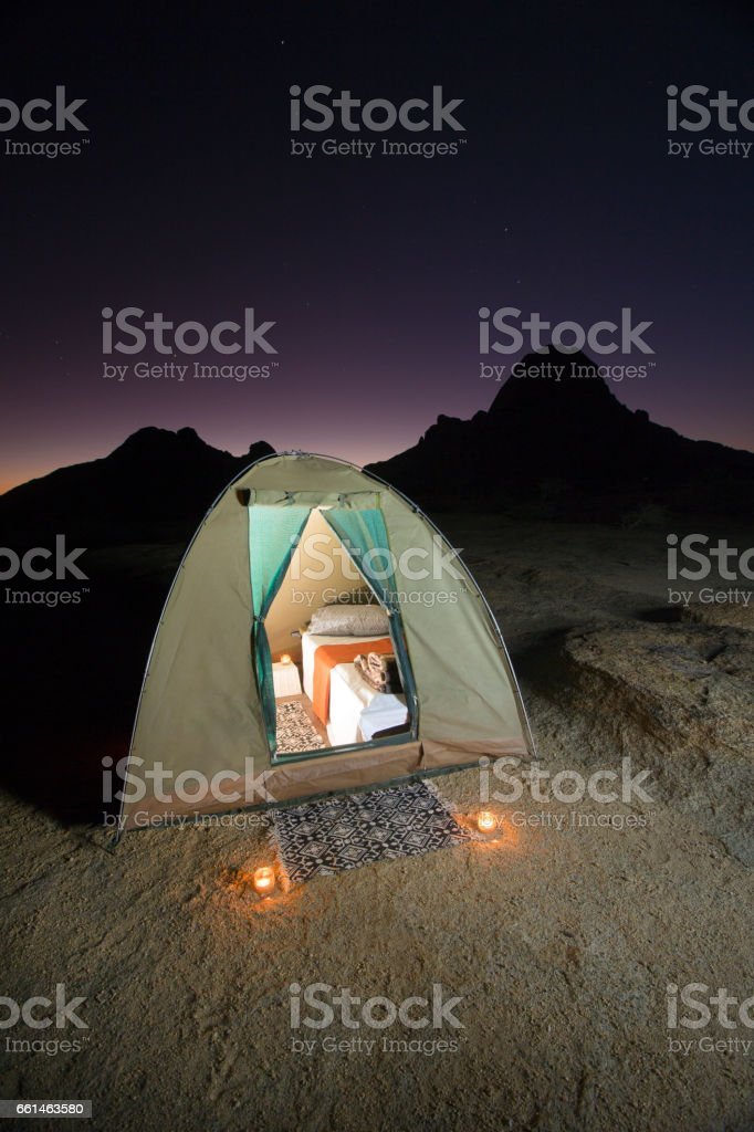 A tent kitted out with luxury bed and bedding stock photo