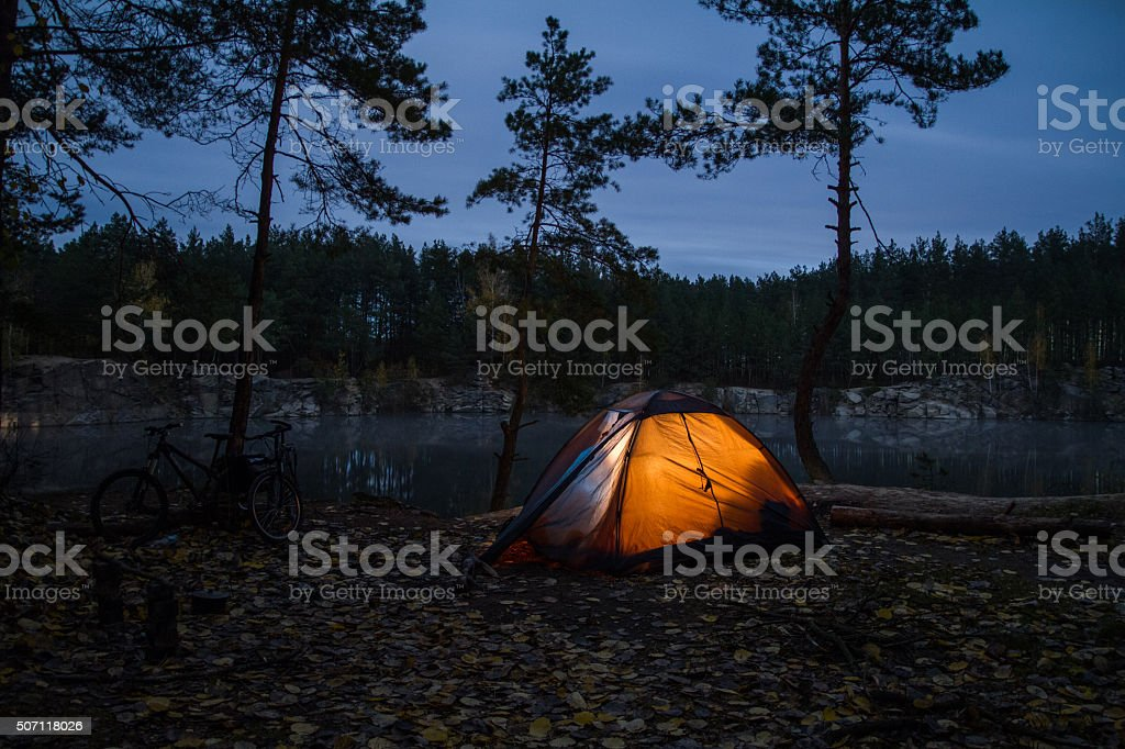 Tent lit up at dusk stock photo