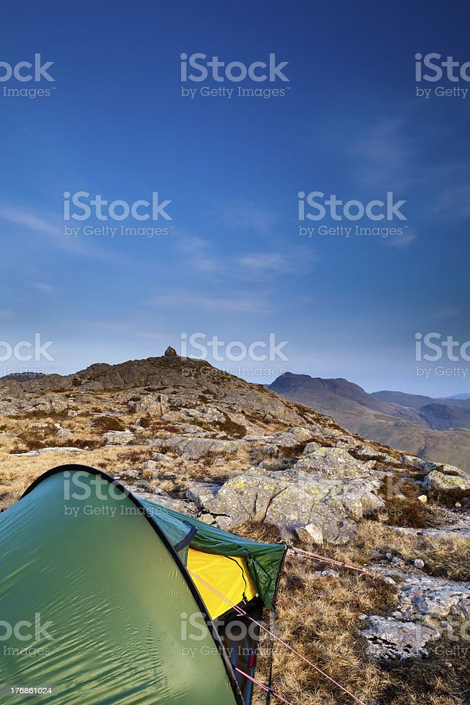 Tent pitched on top of high mountain summit. royalty-free stock photo
