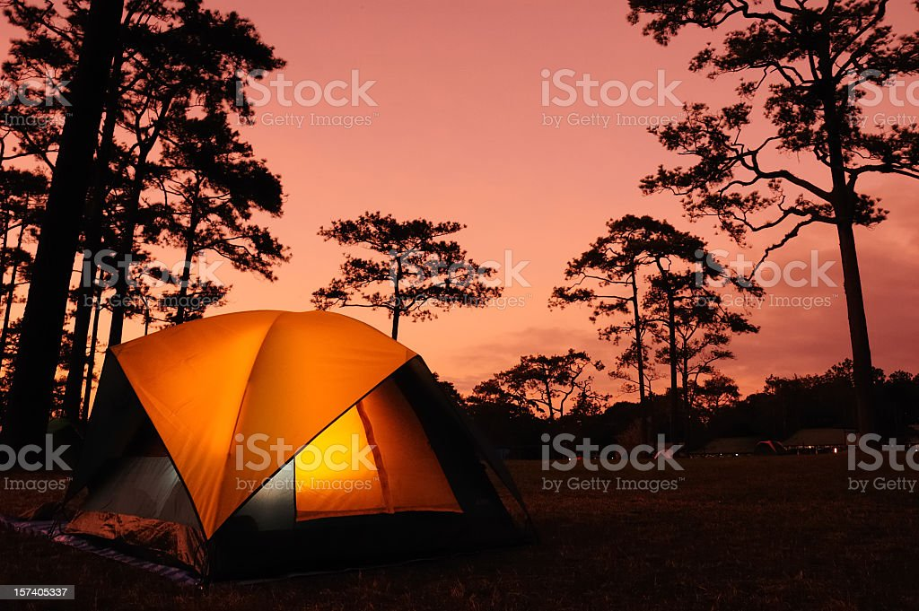 A tent set-up at dusk ready for camping royalty-free stock photo
