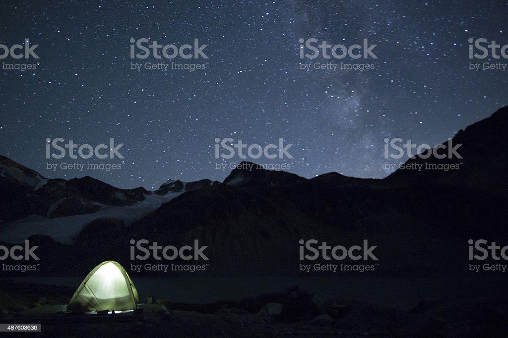 Tent under starry night sky stock photo